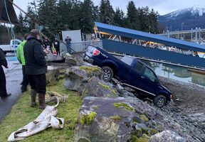 Driver escapes after truck falls into Heritage Harbor
